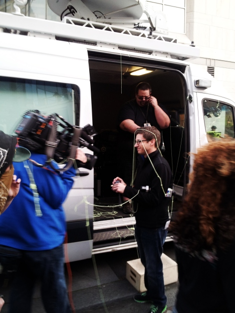 KOMO 4 Newscaster hit with silly string. Photograph by Joey Wieser.