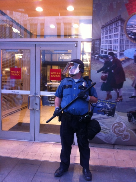Swat Police Officer Protecting Wells Fargo on Fifth Avenue downtown. Photograph by Alexander M. Koch.