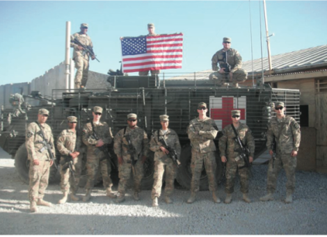 The author's Army medical unit poses in August 2012 in Spin Boldak, Afghanistan, about 25 miles south of Kandahar and near the border of Pakistan. The team included dentists, x-ray techs, mental health specialists, medics, surgeons, and physicians. Photo courtesy of the author.