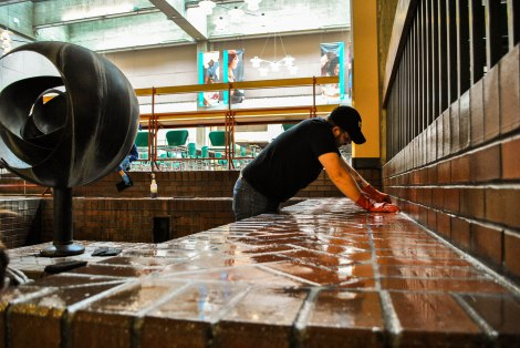 SCCC student Justin gets his hands dirty (photograph by Josh Kelety)